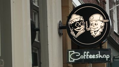 Amsterdaam coffeeshop entrance sign 06e0b79f9