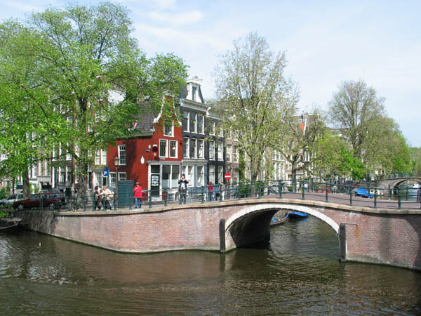 Bridge Over Reguliersgracht To Red House In Amsterdam