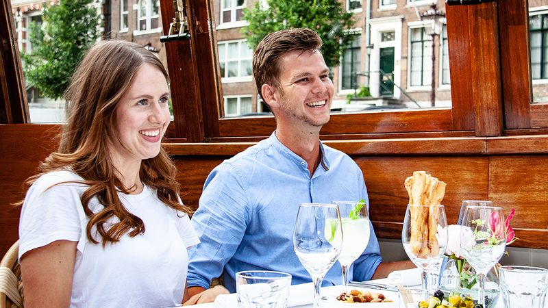 Amsterdam canal cruise luxury dinner guests