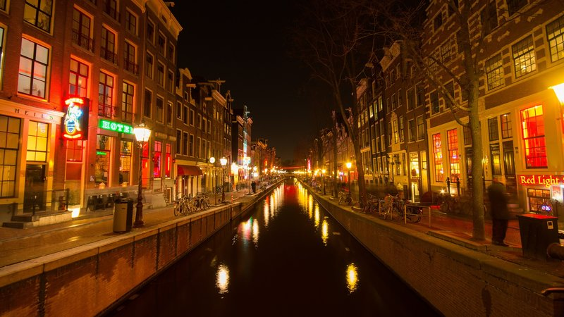 Amsterdam red light district during the night canal view
